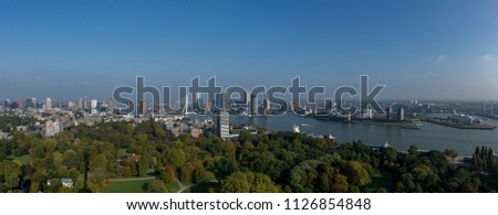 Panoramic cityscape of downtown Rotterdam, The Netherlands, with the city park in the foreground and financial district and city centre including the famous Erasmus bridge in the background #1126854848