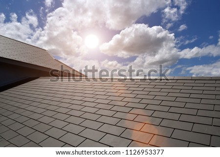 Slate roof house with blue sky at ASEAN #1126953377