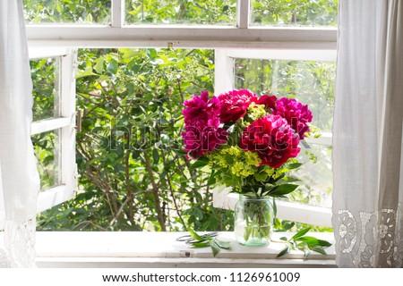 Bouquet of peonies on the windowsill #1126961009