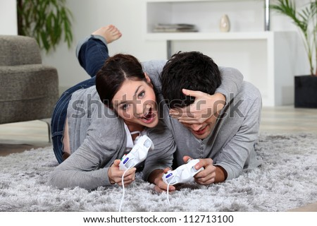 cute couple playing video games #112713100