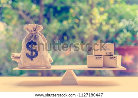 Asset allocation and portfolio management concept : Dollar bag, financial product boxes on a simple balance scale, depicts diversifying personal asset for long term sustainable growth with low risk #1127180447