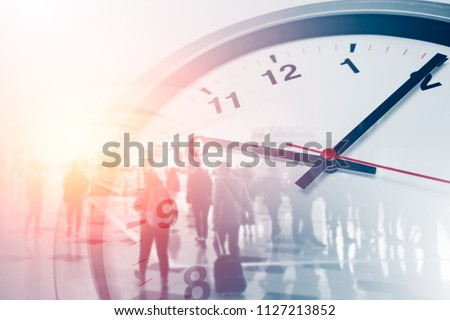 Business times concept people walking overlay with time clock #1127213852