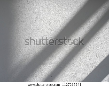 The sun light casting abstract shadow over the white concrete wall,sunshade shadow #1127217941