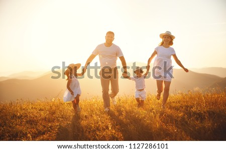 Happy family: mother, father, children son and  daughter on nature  on sunset #1127286101