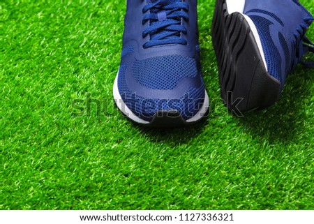 Sport shoes on grass #1127336321