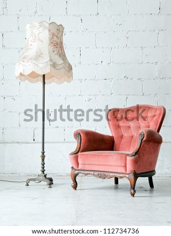 Pink classical style Armchair sofa couch in vintage room with desk lamp #112734736