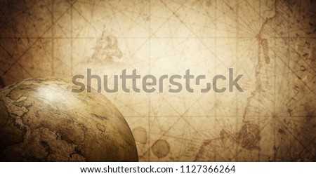 Ancient old globe on the vintage map background. Selective focus. Retro style. Science, education, travel, vintage background. History and geography team. #1127366264