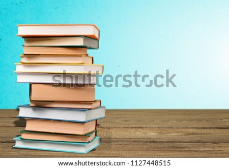 Opened Book on wooden table #1127448515
