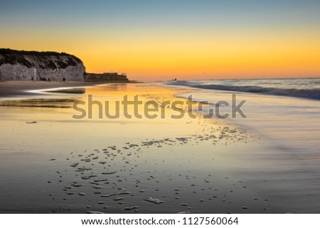 Sunset reflected in the wet sand on Botany Bay beach in north Kent #1127560064