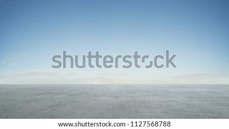 Empty asphalt floor with blue sky . Royalty-Free Stock Photo #1127568788