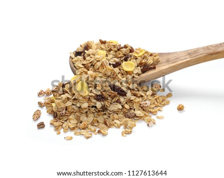 Crunchy granola, muesli pile with wooden spoon isolated on white #1127613644