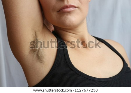 Female hairy armpit, unshaved underarms new fashion trend concept. #1127677238
