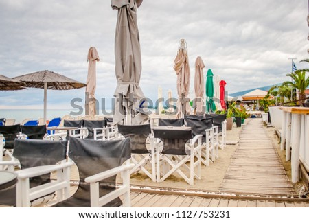 Leptokarya, Greece - June 25, 2018: Cafes on the seashore, with details and beautiful ambience #1127753231