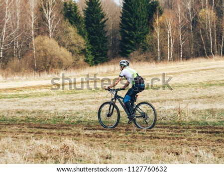 April 15, 2018, Krevo, Belarus.Beetle Trail Krevo A man runs alongside a riding bicyclist #1127760632