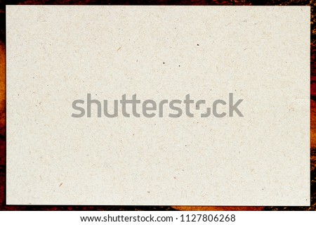 Organic light cream paper in patterned frame, recyclable material, has small inclusions of cellulose. Blank for your design #1127806268