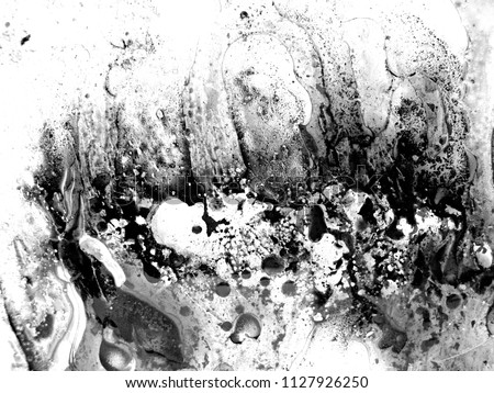 abstract art background . oil and water. The texture of the surface is mixed with water and acrylic and oil. The abstract image is in the form of free white and black.