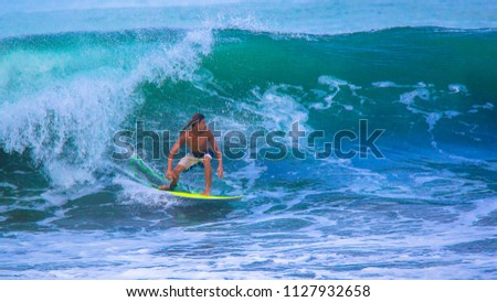 Riding in the waves. Costa Rica, surfing paradise. Alberto Muñoz, a costarican top ten surfer #1127932658