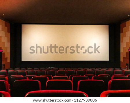 Red theater seat and screen without people. #1127939006