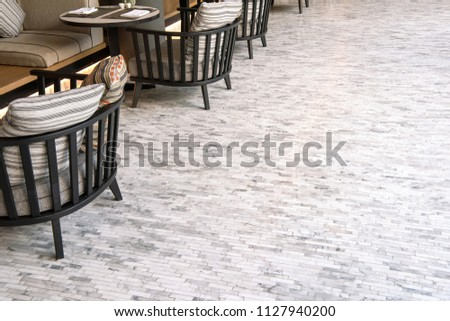 White marble tile flooring, outdoor living room.