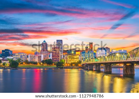 Portland, Oregon, USA skyline at dusk on the Willamette River.