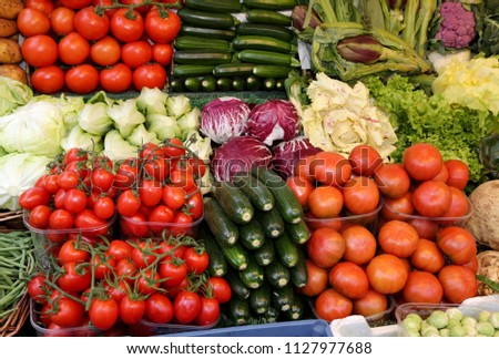 many fresh vegetables and fruits for sale at local market #1127977688