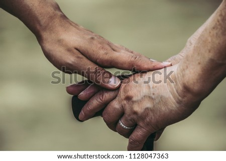 Shaking hands with the elderly #1128047363