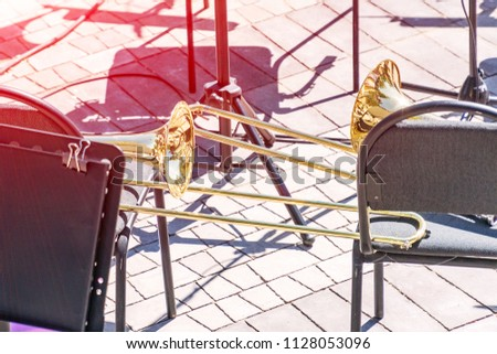 A trombone on a chair. Empty seats in the orchestra #1128053096