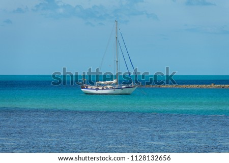 White  boat  on   the  blue  sea   and  blue sky  background #1128132656