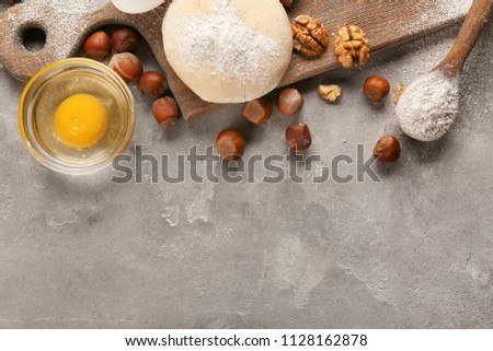 Ingredients for preparing bakery on grey background #1128162878