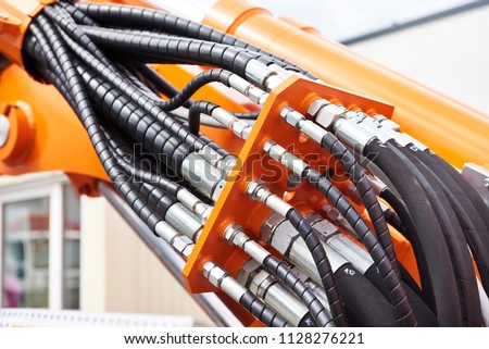 Hoses of modern hydraulic machine Royalty-Free Stock Photo #1128276221