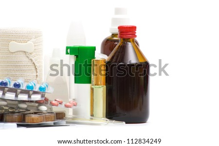 Medical bottles with  tablets isolated on white #112834249
