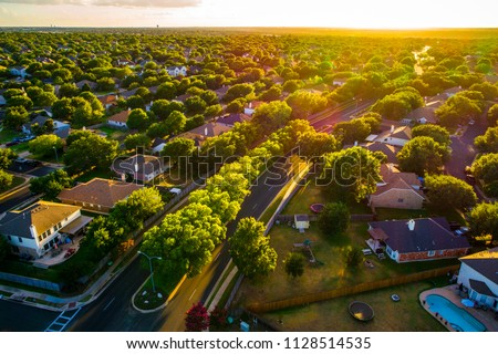 Sunny days ahead, Sunset real estate suburb homes. Community suburbia neighborhood in north Austin in suburb Round Rock , Texas Aerial drone view above new development Royalty-Free Stock Photo #1128514535