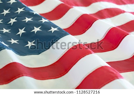 Close up photograph of a rippling American Flag  #1128527216
