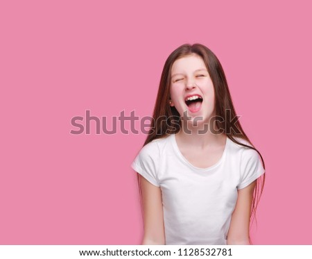 Funny girl screaming loud with closed eyes #1128532781