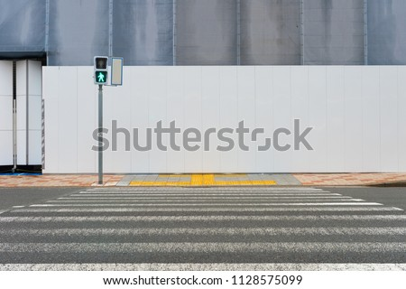 street wall background ,Industrial background, empty grunge urban street with warehouse brick wall Royalty-Free Stock Photo #1128575099