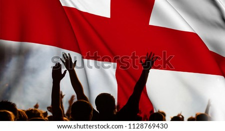 england supporters - double exposure of England flag and football fans celebrating victory #1128769430