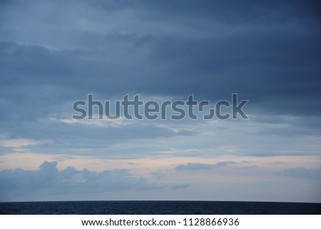 Seascape on the dark clouds background before a thunderstorm  #1128866936