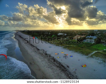 Mansions on the beach at sunset #1128923534