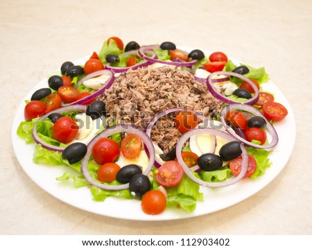 Tuna salad, olives, tomatoes, lettuce, eggs and olive oil #112903402