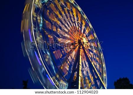 Ferris Wheel at amusement park #112904020