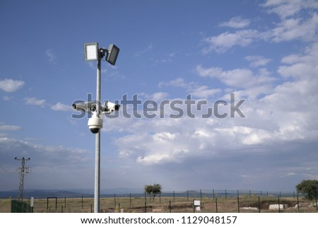 security camera and lamp #1129048157