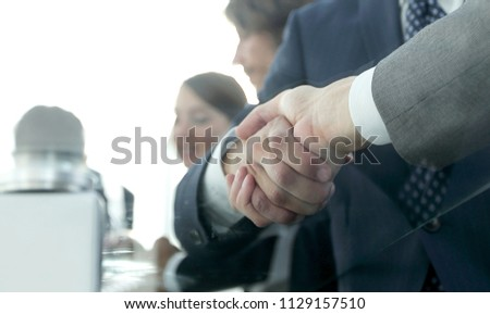 handshake of business partners in conference room #1129157510