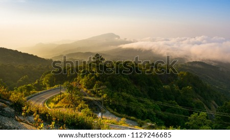 mountain view and sunrise the forest with road on the morning at Doi Inthanon National Park, Chiang Mai, Thailand. #1129246685