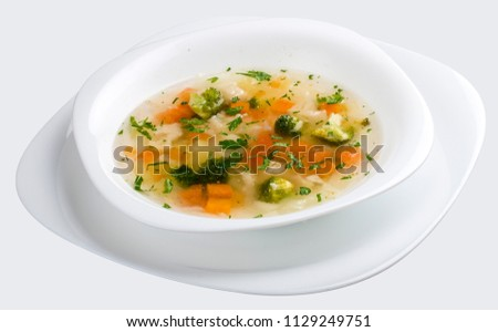 Vegetable soup with broccoli on white background #1129249751