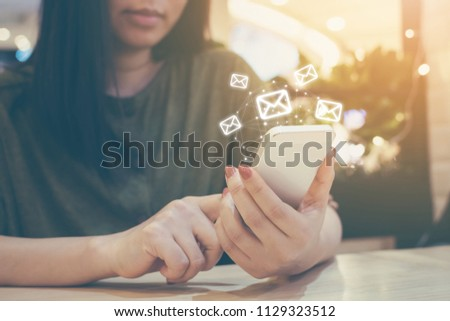 Happy woman hand using mobile phone with e-mail application, Concept email marketing and newsletter #1129323512