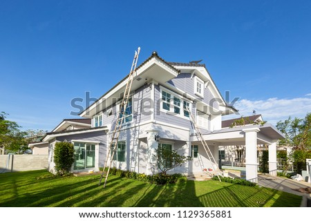 Exterior view of new house under construction and painting.Home renovation and construction concepts Royalty-Free Stock Photo #1129365881