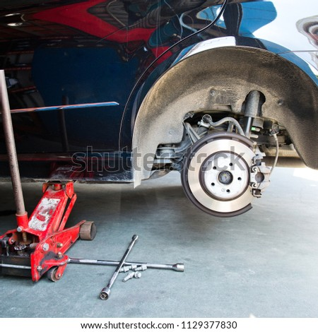 Car without tire need to be repaired. #1129377830