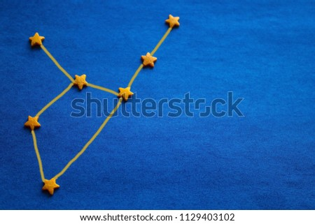 Constellation Virgo on a blue background. Astrology, compilation of a personal horoscope by date of birth. View from above. The picture is made by the author.