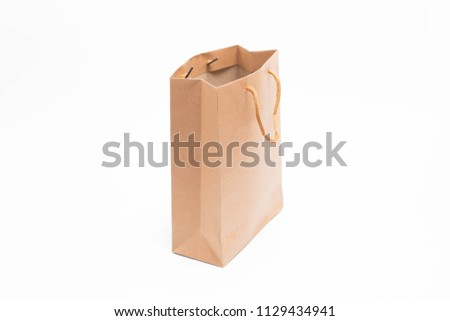 Recycled paper shopping bag on white background #1129434941