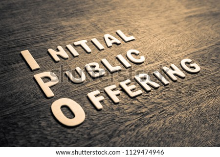 IPO abbreviation of Initial Public Offering text by wood letters #1129474946